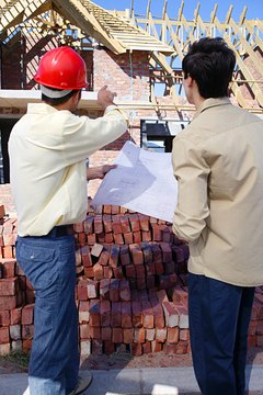 Resident engineers instruct staff on construction procedures.