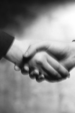 black and white close-up of a handshake