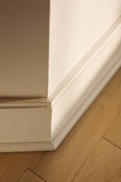 Baseboard can be removed without damaging it or the wall.