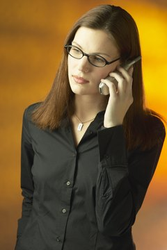 Woman in eyeglasses on cell phone