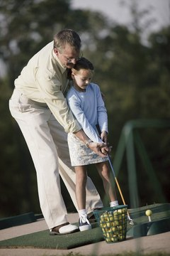 Teaching children how to golf at a young age can be challenging, but can also create a fun parent-child pastime.