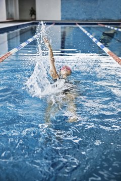 Competitive backstrokers aim to achieve powerful kicks.