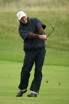 Even this far into his finish, Greg Norman's back knee stays bent so that his back foot doesn't slide.