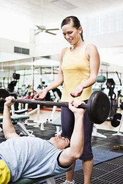 Use a spotter to reduce risk of weightlifting injuries.