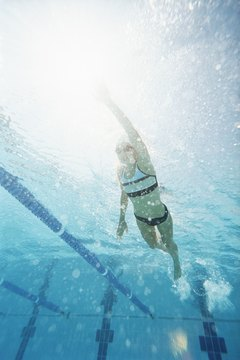 Focus on pulling your navel toward your spine throughout your swim workout.