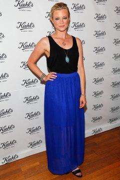 Actress Amy Smart wears a cobalt maxi skirt with a black tank top at an event in Santa Monica in 2013.