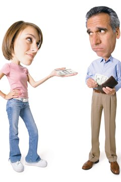 conceptual caricature of caucasian father as he gives money from his wallet to his teenage daughter