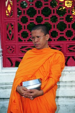 A Buddhist monk on morning alms round