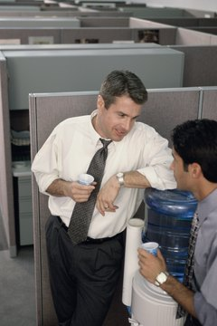 Two business executives talking at a water cooler