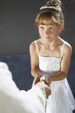 Traditionally, children wear white for their first communion.