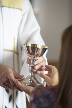 Before Catholics receive Communion, they must fast and be free of grave sin.