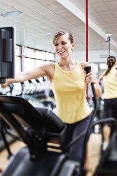 Tone your arms and shrink your waistline with the elliptical machine.