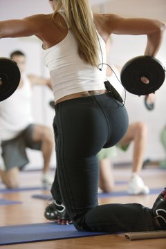 Weighted lunges engage the glutes.