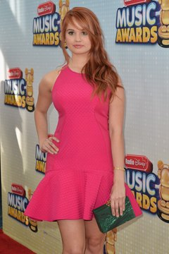 Actress Debby Ryan incorporates a pop of color with a jade clutch at the Radio Music Disney Awards in Los Angeles in April 2013.