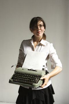 Woman holding typewriter