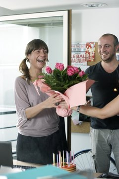 Only surprise her at work if you're sure her employer allows it.