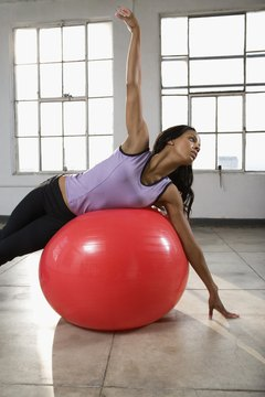 Pilates targets the abs to tighten and lengthen.