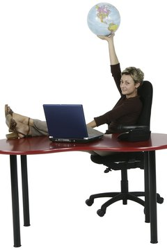 Businesswoman Sitting at Desk with Globe