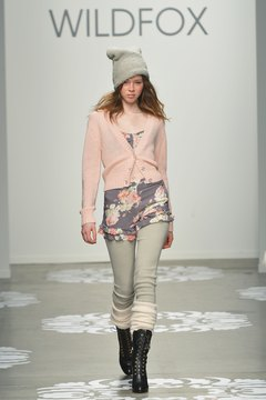 A model rocks a light pink cardigan with a gray-and-pink floral top at the February 2014 Wildfox runway show in New York.