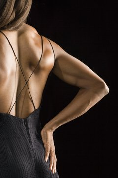 Reveal a toned, sexy back achieved with dumbbell exercises.