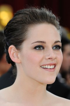Actress Kristen Stewart's dark hair and smoky eyes set off her pale skin.