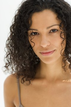 Curly hair is often defined and smoothed with product, instead of heat.