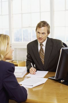 businessman interviewing a businesswoman