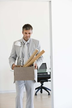 Businessman with box of supplies