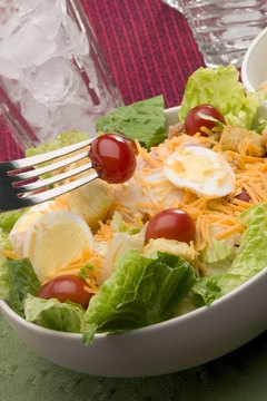 If you're careful about cholesterol, hard-boiled eggs can be a healthy salad topping.