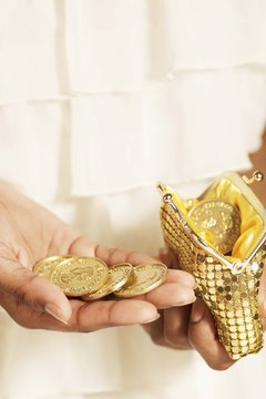 Gold jewelry and coins commonly carry a karat indicator.