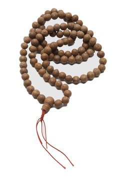 Mala beads are used to create blessings.