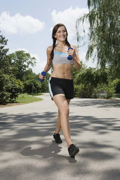Pump up your walk with a pair of hand weights.