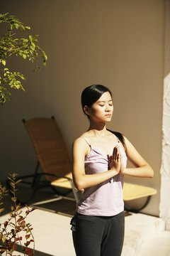 Prayer pose is the first position in Suyra Namaskar.