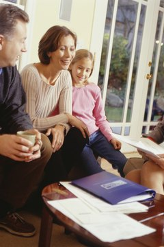 Parents and daughter (10-11) with financial advisor