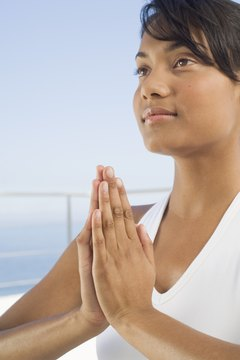 "Bringing your hands to your heart and greeting others with ""Namaste"" helps you focus on your yoga practice."