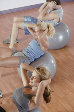 Traditional crunches tone ab muscles; adding weight can increase the challenge.