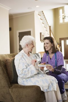 Nurse and patient at home with medication