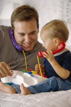 Play games with your toddler using age-appropriate toys that stimulate and encourage him.