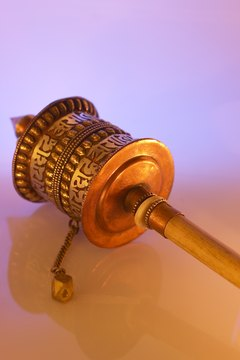 This small Tibetan prayer wheel has the words of a prayer embossed on its surface.