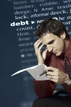 Learn how to cope with a husband who's running up debt.