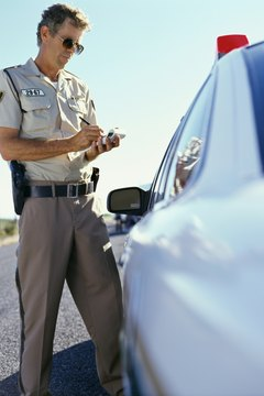Police issuing a speeding ticket.