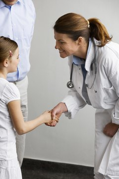 Doctor shaking hands with girl