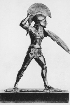 A Greek hoplight wearing his Corinthian helmet with horsehair crest.
