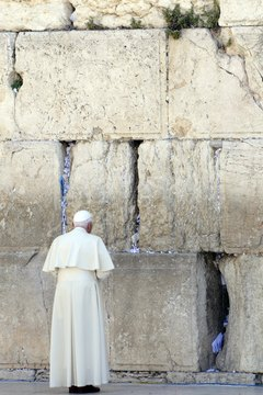 The pope prays at the Wailing Wall, one of Judaism's holiest sites.