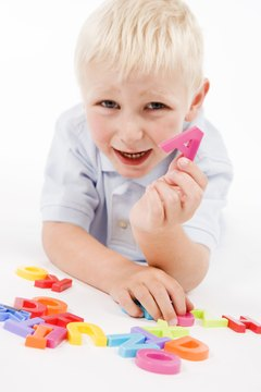 Young children can use magnetic letters to create words.