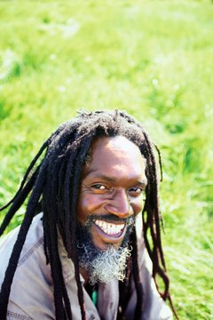 A Rastaman, with hair in dreadlocks, worn by many of the faithful.