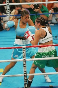 Muhammad Ali's daughter Laila, left, was a pro boxing champion.