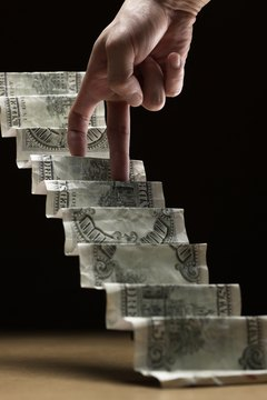 hand climbing up stairs made of dollar bills