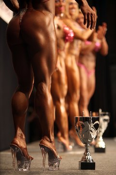 Female bodybuilding physiques are lean, muscular and sculpted.