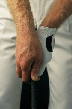 While it might seem uncomfortable initially, a proper grip will feel natural with practice.